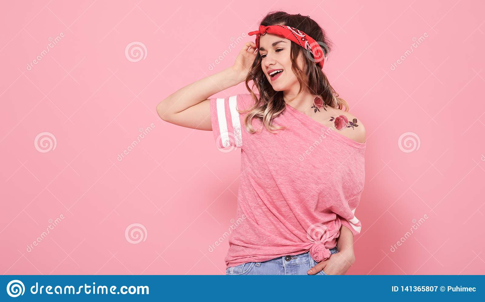 Portrait of a hipster girl with tattoo,  on pink background
