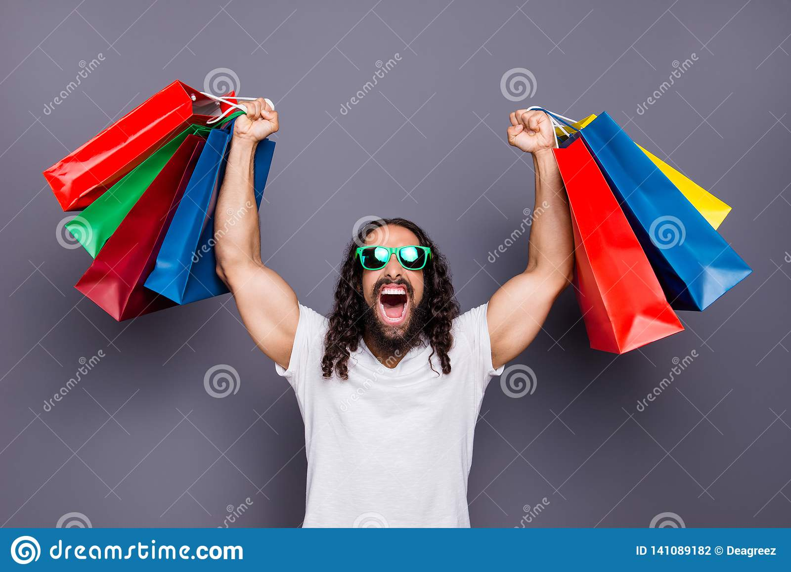 Portrait of his he trendy attractive cheerful cheery crazy ecstatic wavy-haired guy 3d eyeglasses eyewear holding in