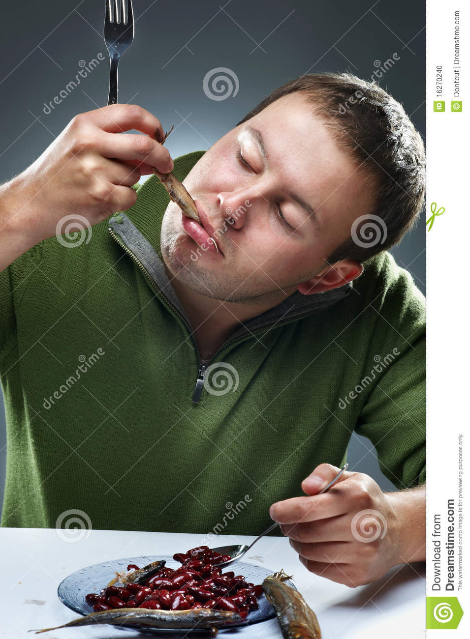 Fun portrait of man with fish in mouth royalty free stock for Dreaming of eating fish