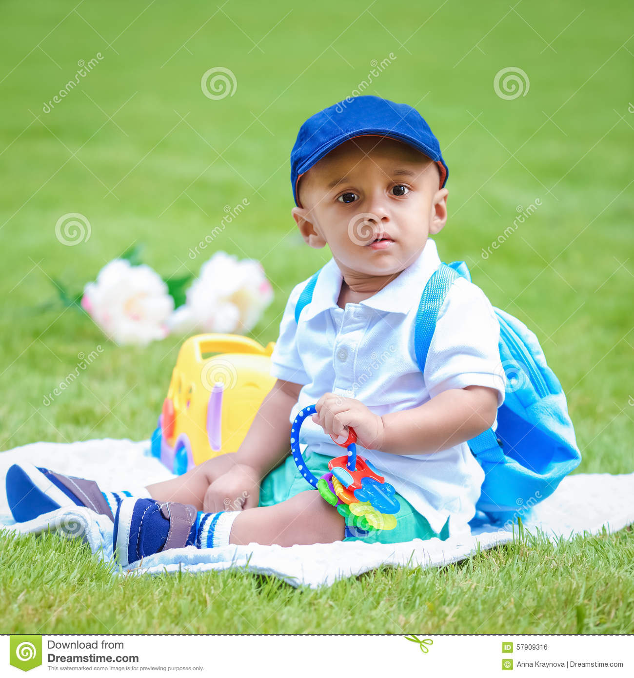 Portrait Of Indian Baby Boy With Backpack Sitting On Ground Stock ... e3c63689831d0