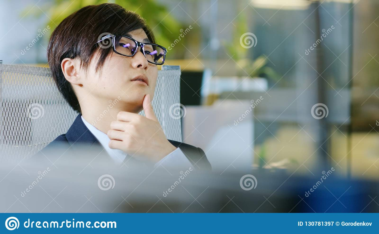 Portrait of the Japanese Businessman Wearing Suit and Glasses, S