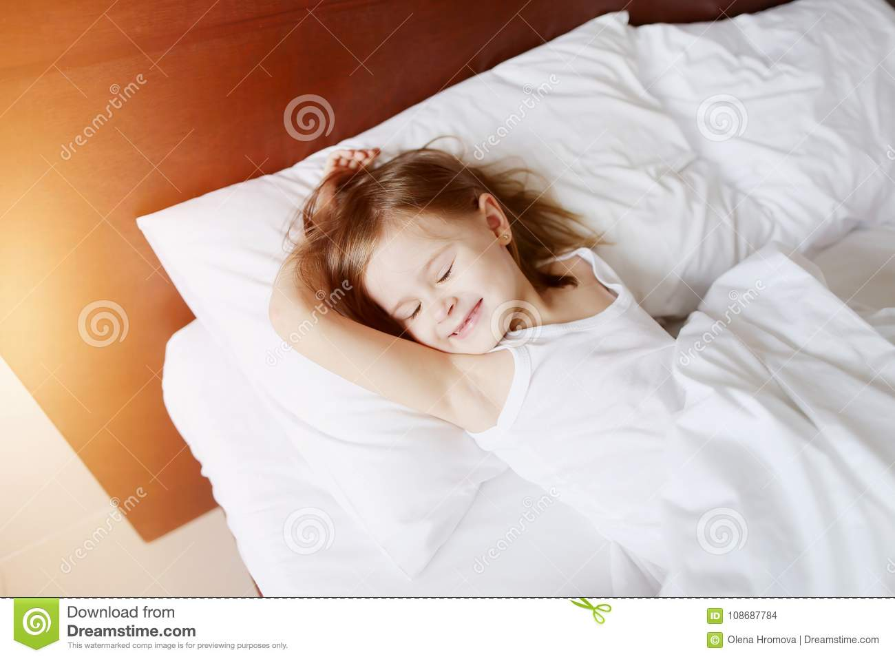Portrait Of Kid Daughter Sleeping Laying At White Bed Home On Sunny