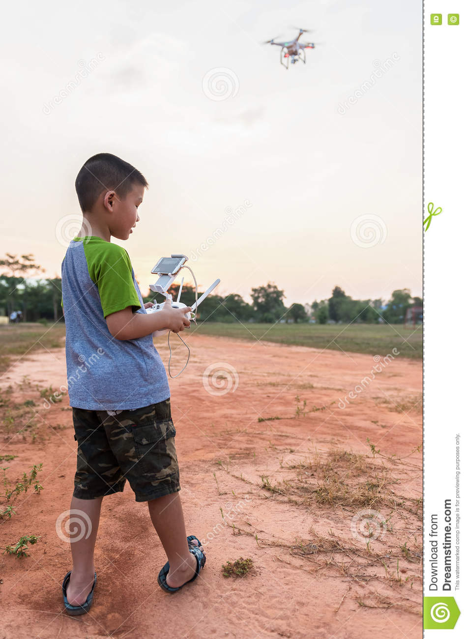 Portrait Of Kid With Quadcopter Drone Outdoors Stock Image - Image