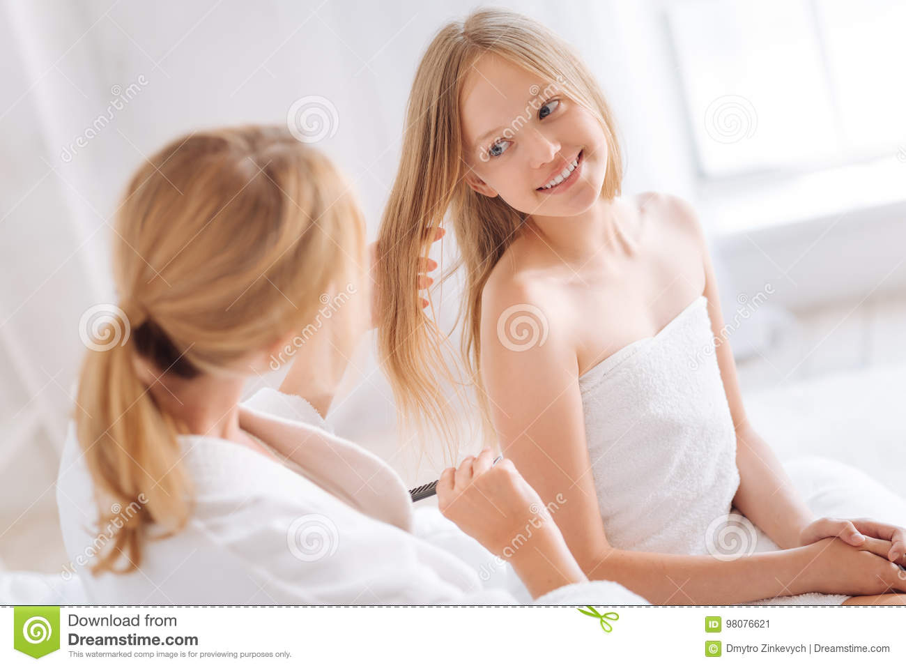 Portrait Of Kind Girl That Looking At Her Mom
