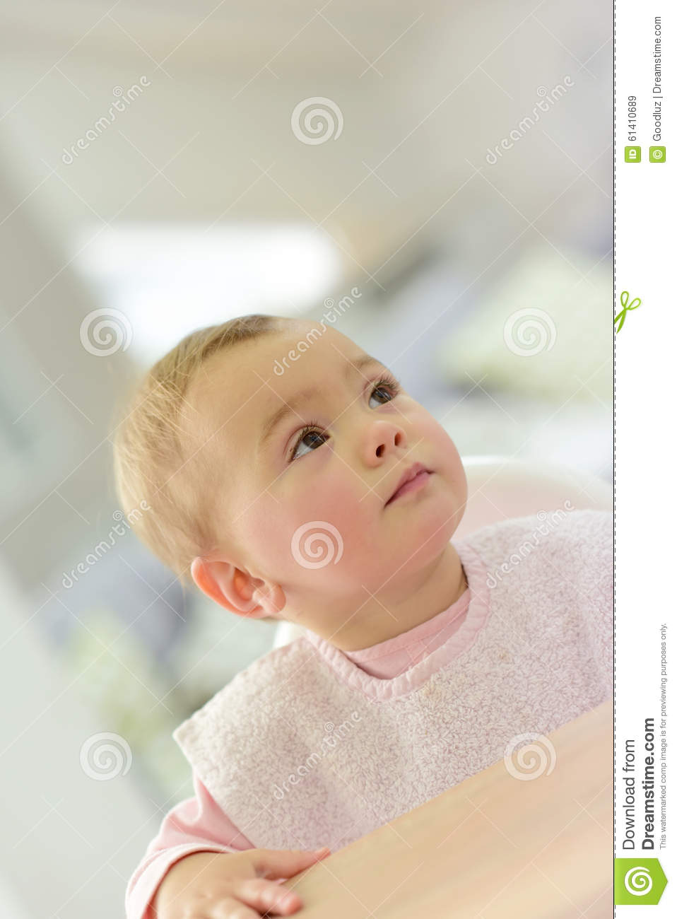Portrait Of Little Baby Girl Waiting For Food Stock Photo