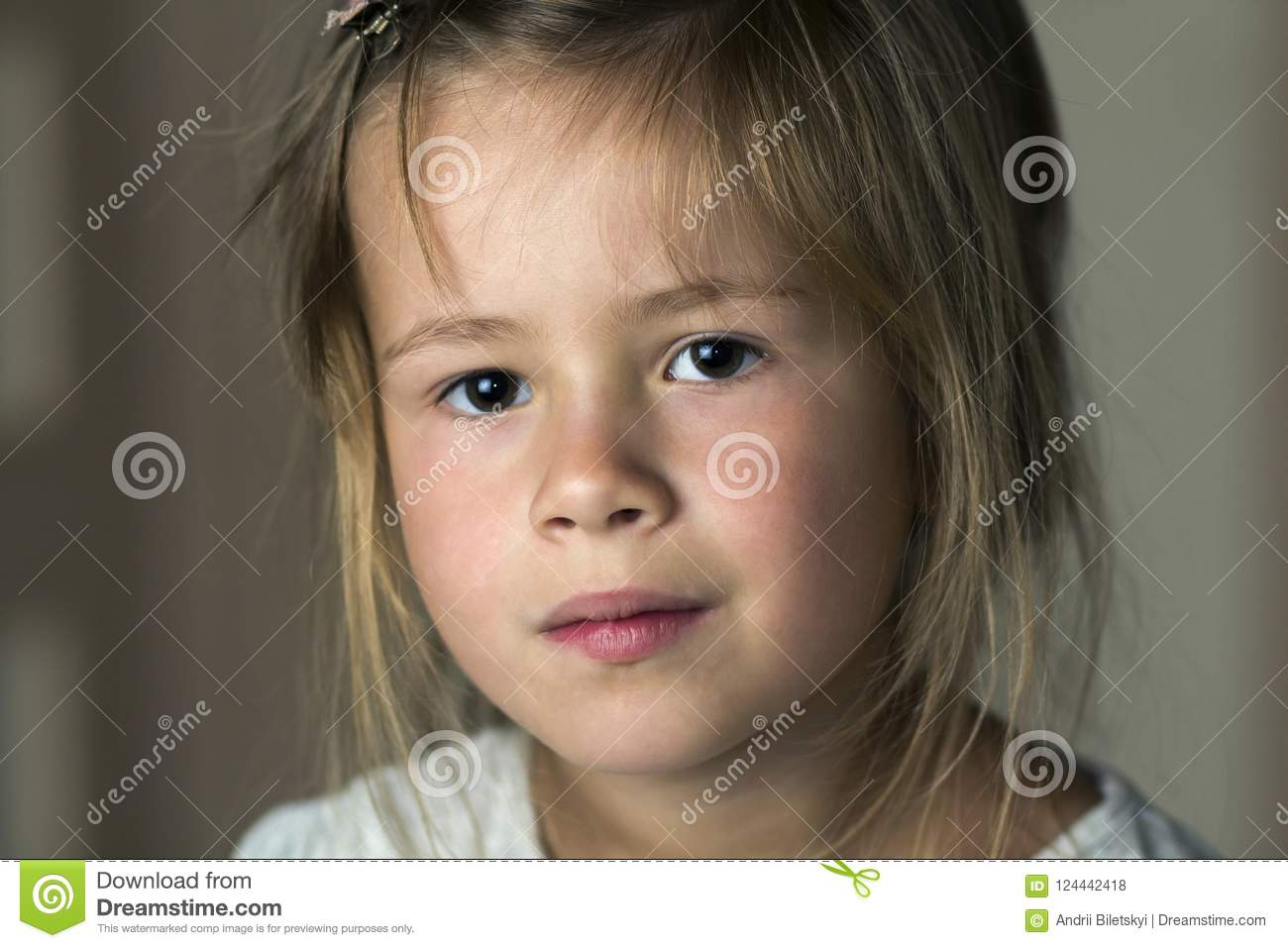 Portrait of little cute pretty young child girl with gray eyes a