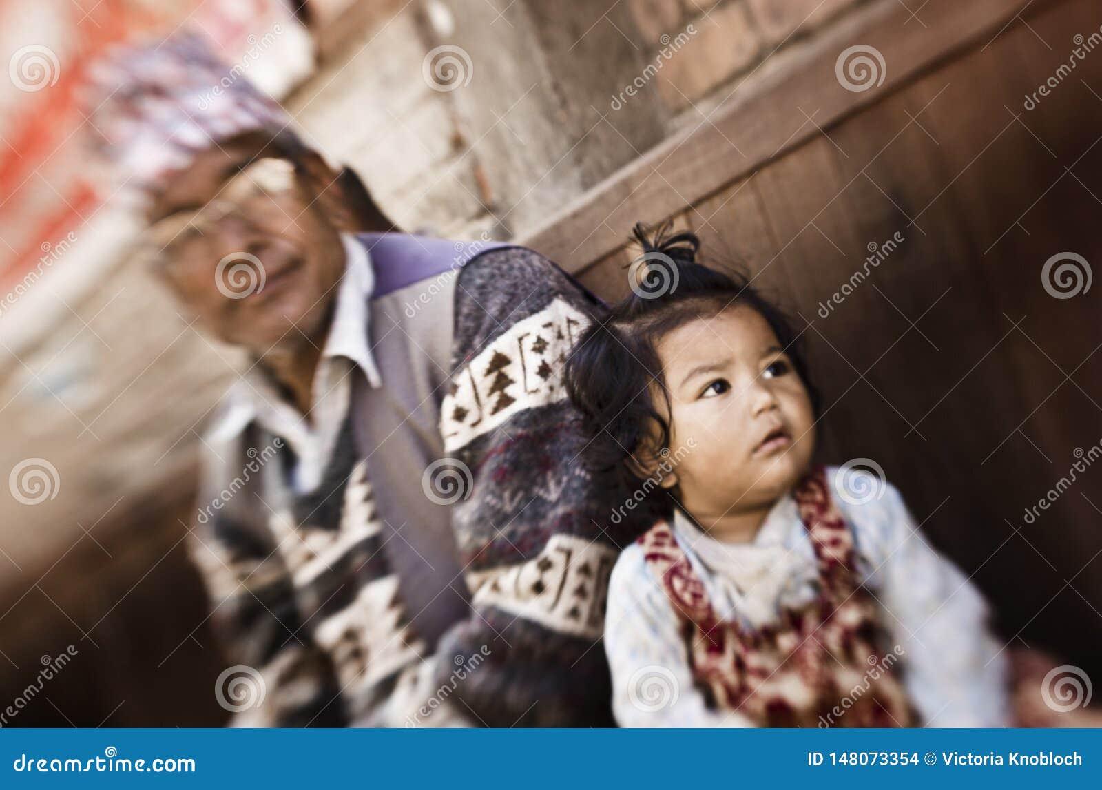 Little girl and father in Kathmandu