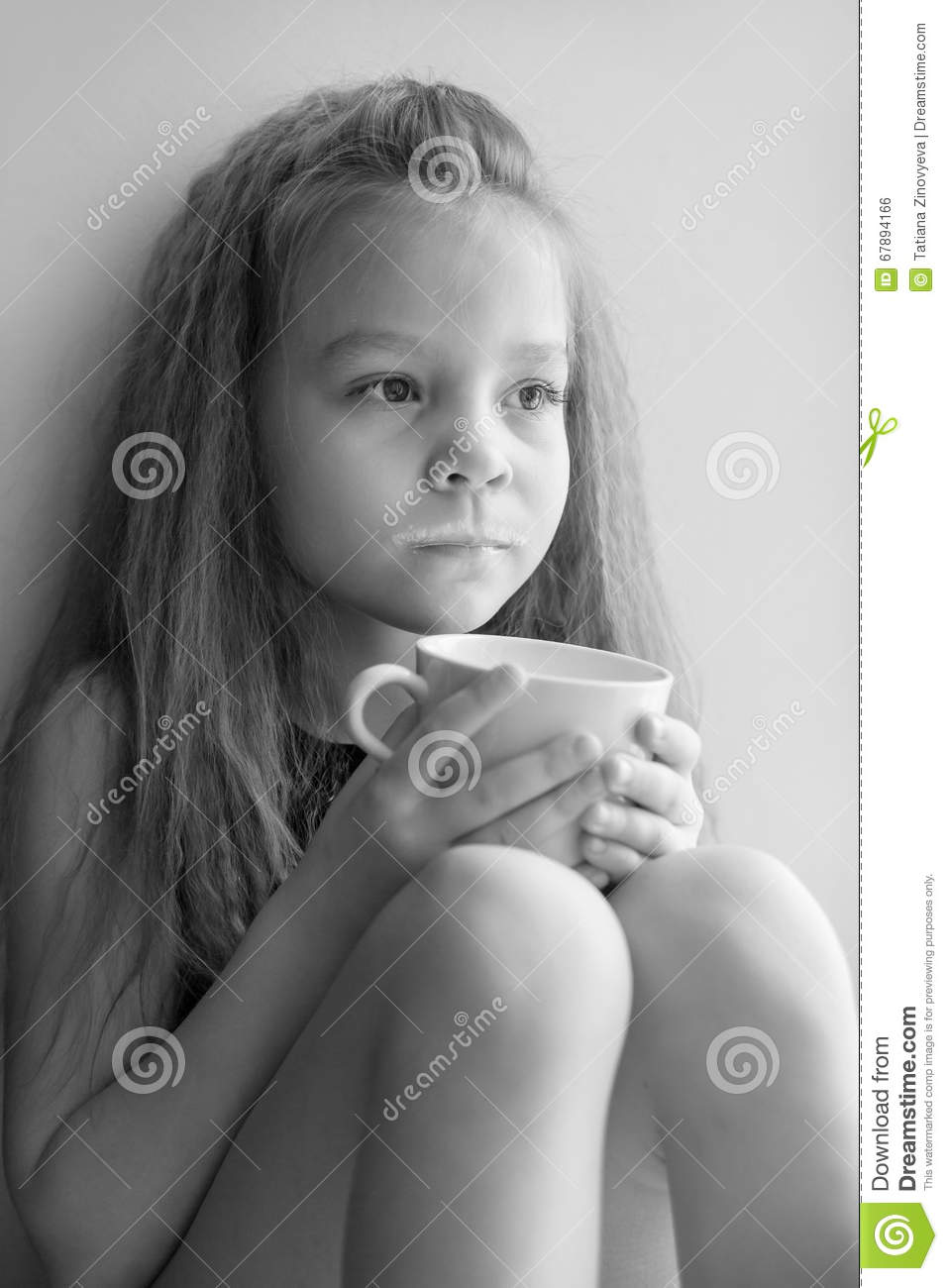 Little girl with a mug of hot milk black and white portrait