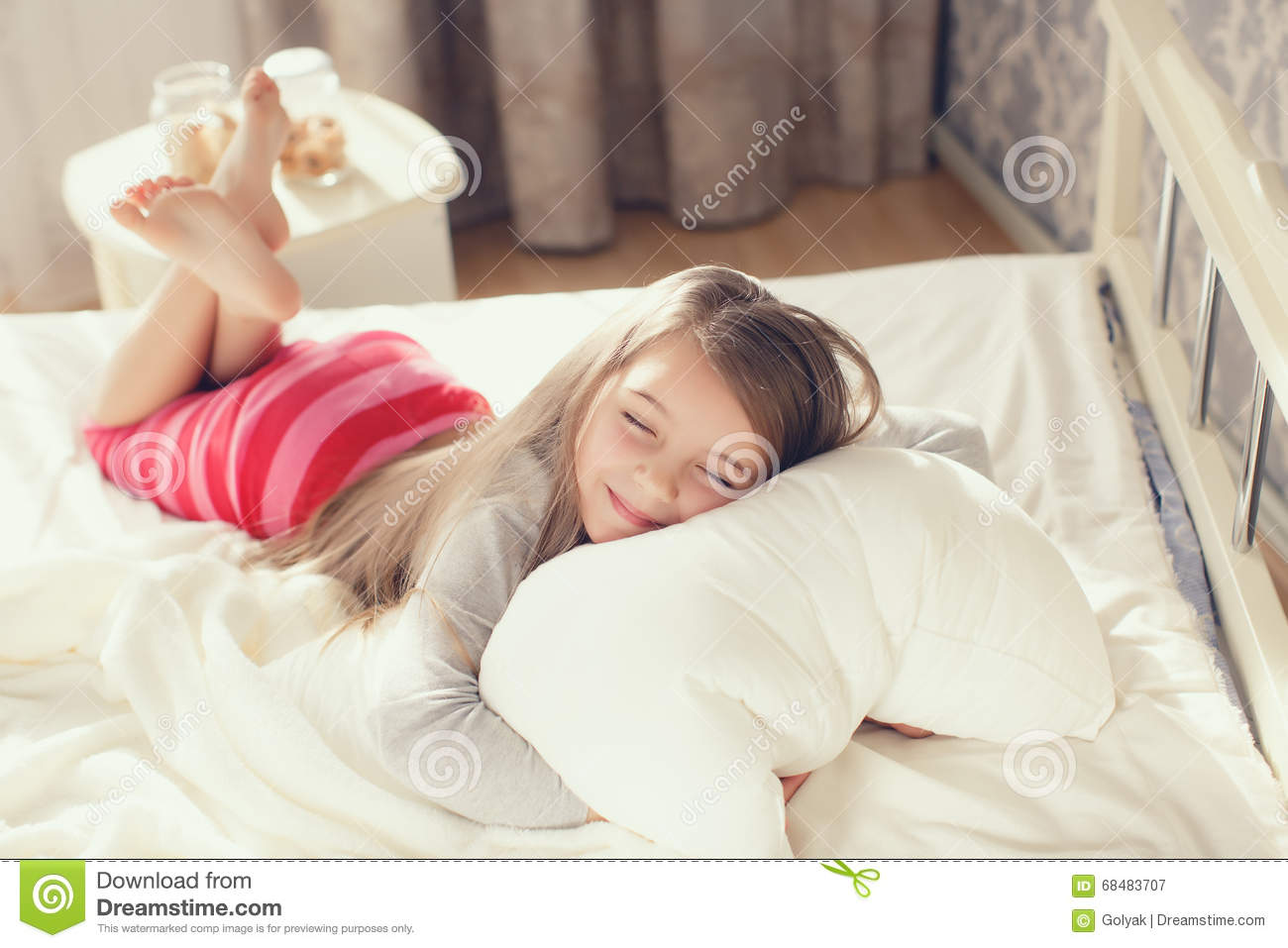 Portrait Of A Little Girl Hugging A Pillow Stock Image