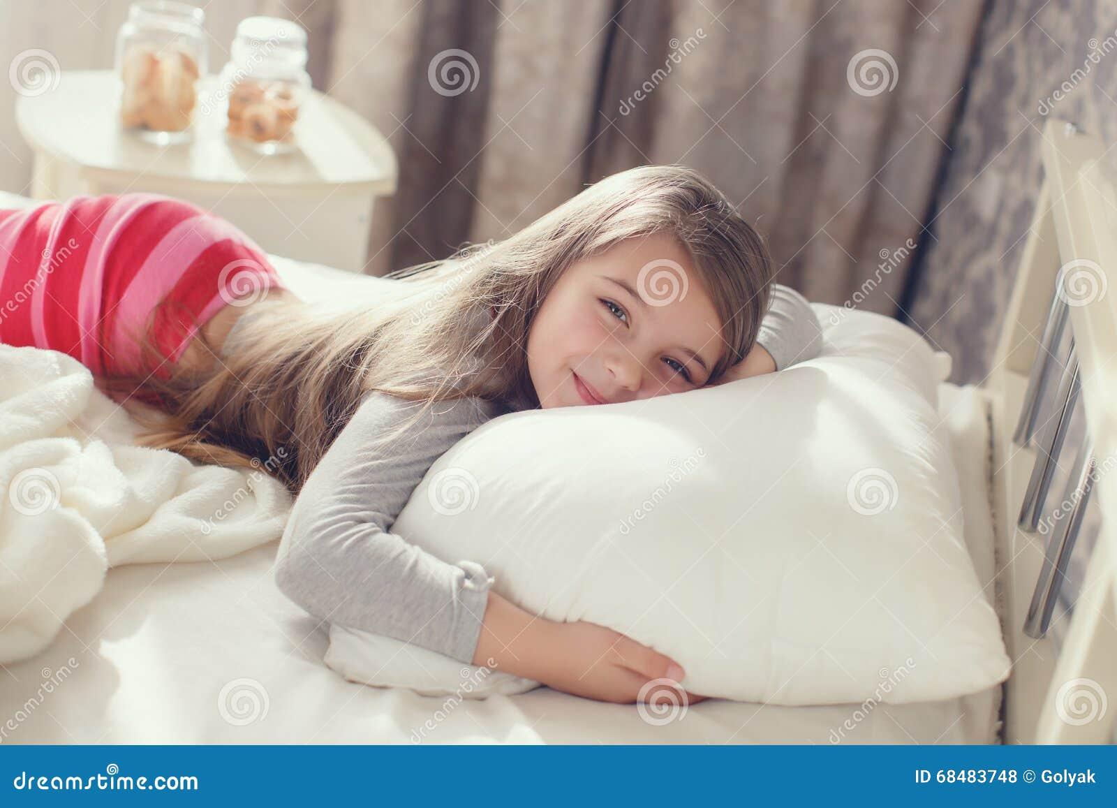 Portrait Of A Little Girl Hugging A Pillow