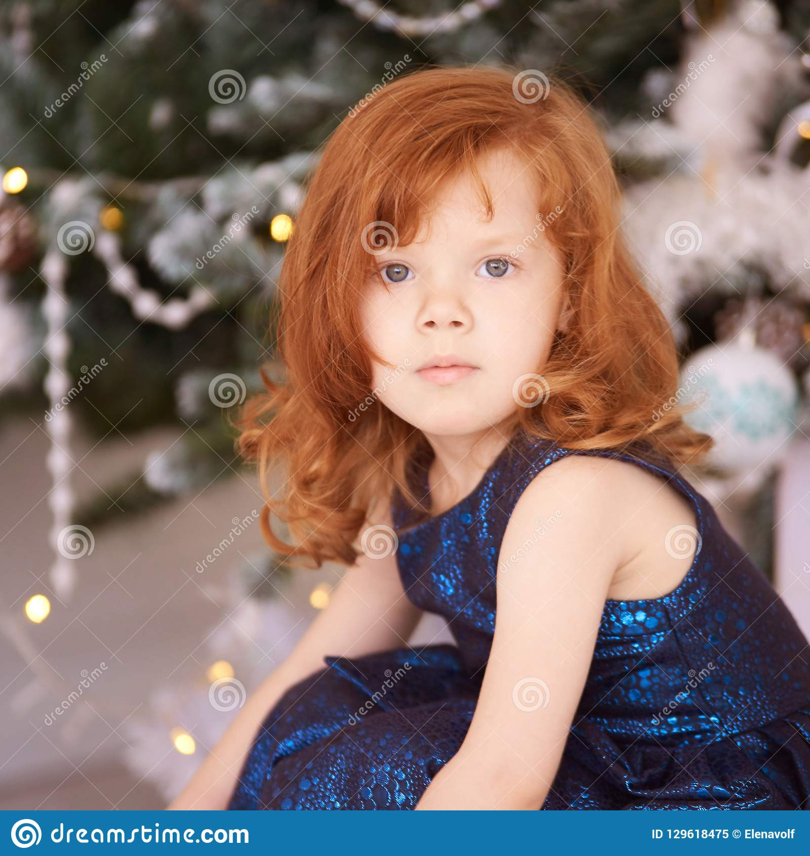 Portrait of little girl. New Year xmas child. Christmas eve holiday. interior. interior. Horizontal