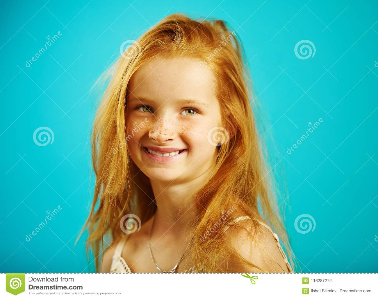 Portrait of little girl seven years old with fiery red hair, cute freckles, smiling sincerely, expresses confidence and
