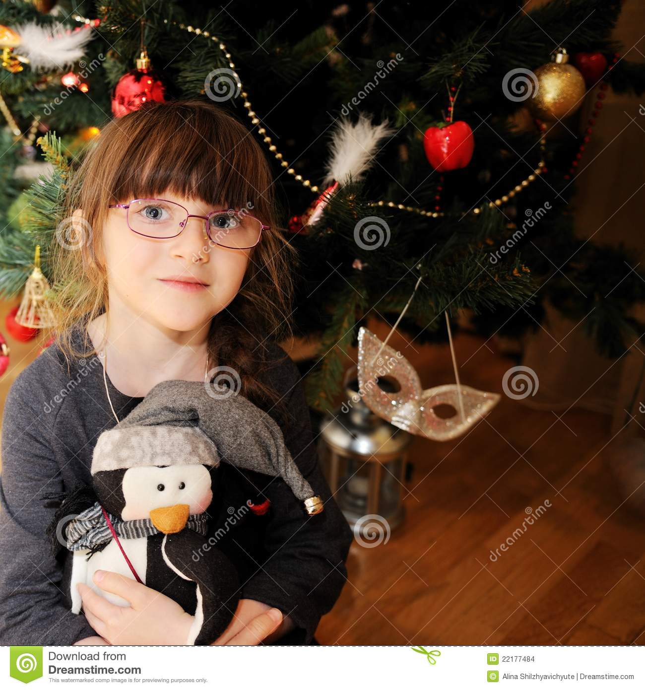 Little Girl Christmas Tree: Portrait Of Little Girl Under Christmas Tree Stock Photo