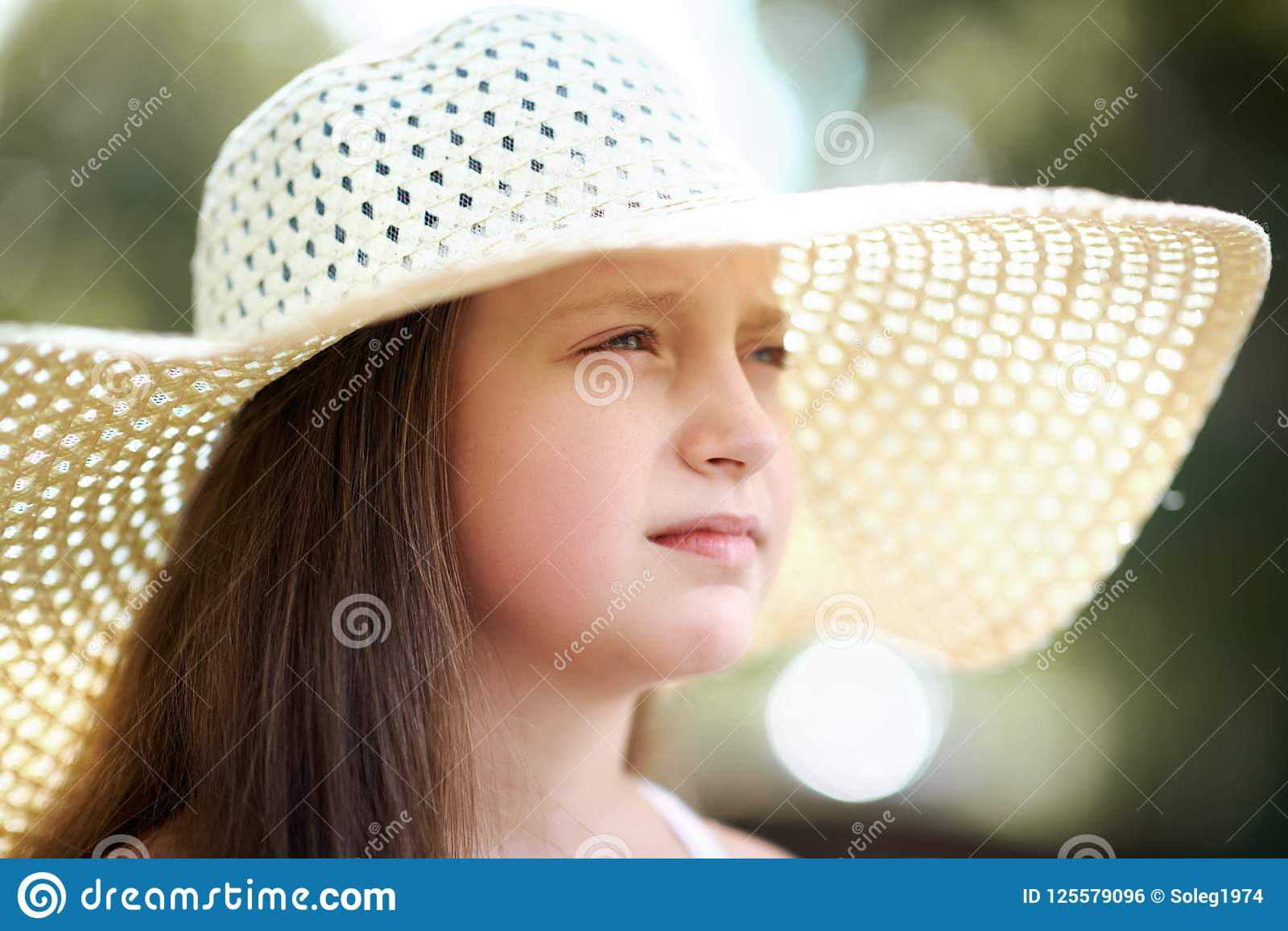 4eb29ec67 Portrait Of A Little Girl Wearing A Big Hat