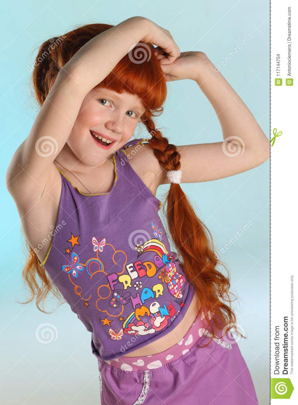 Portrait of little redhead pre-teen fashion girl-model in a summer clothes
