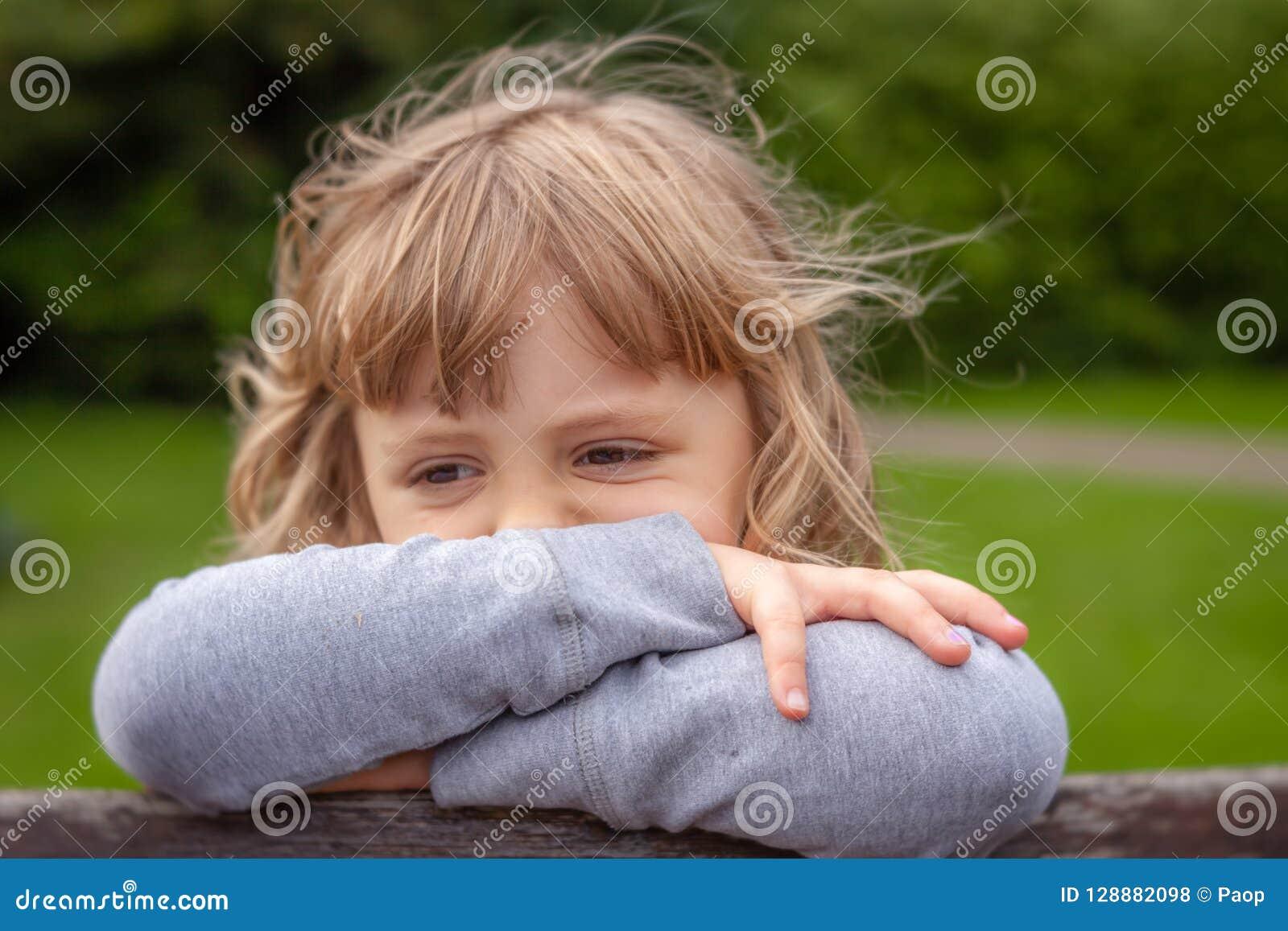Portrait of a little sad Caucasian girl