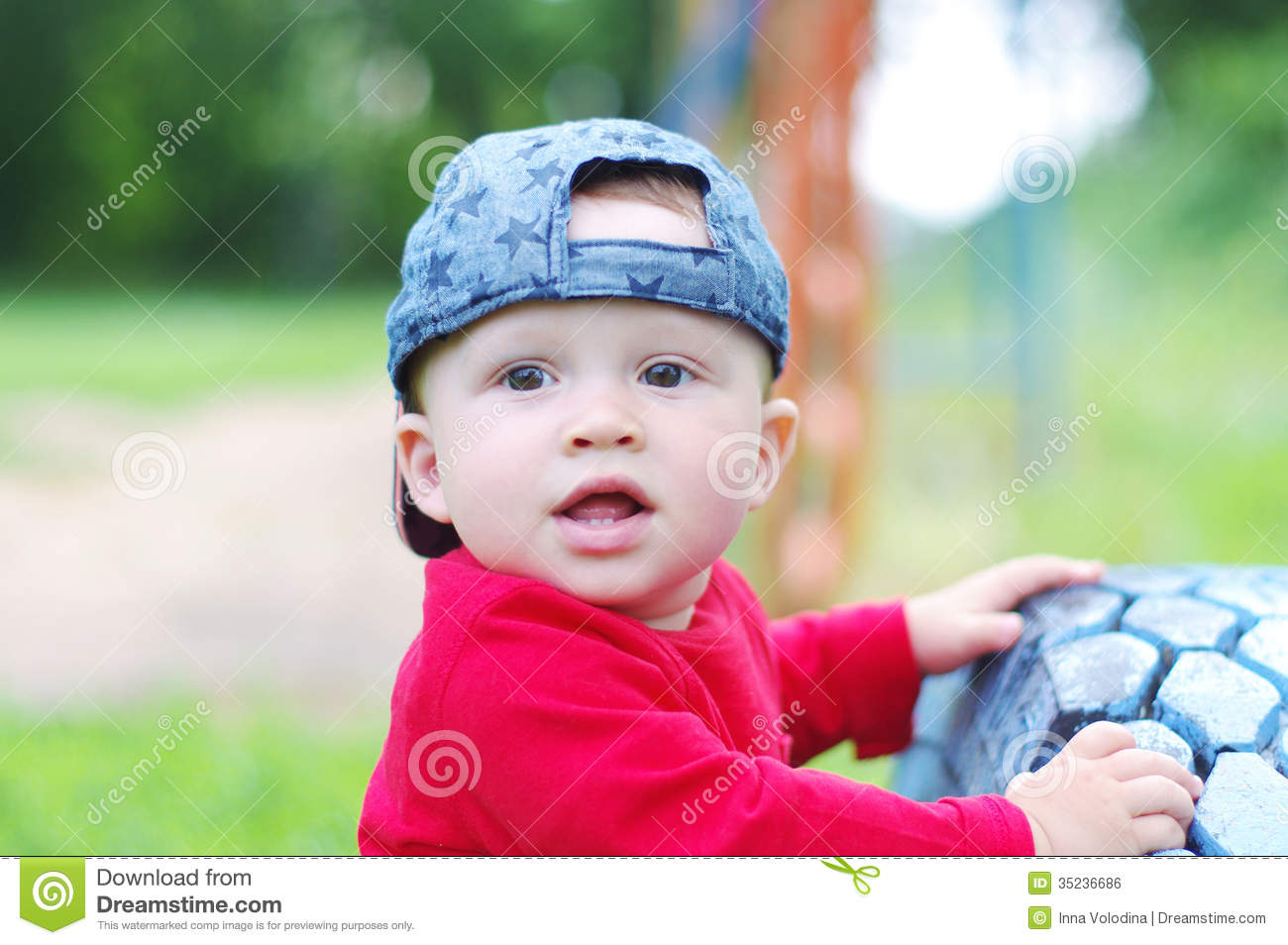 portrait of lovely baby boy age of 10 months outdoors stock photo