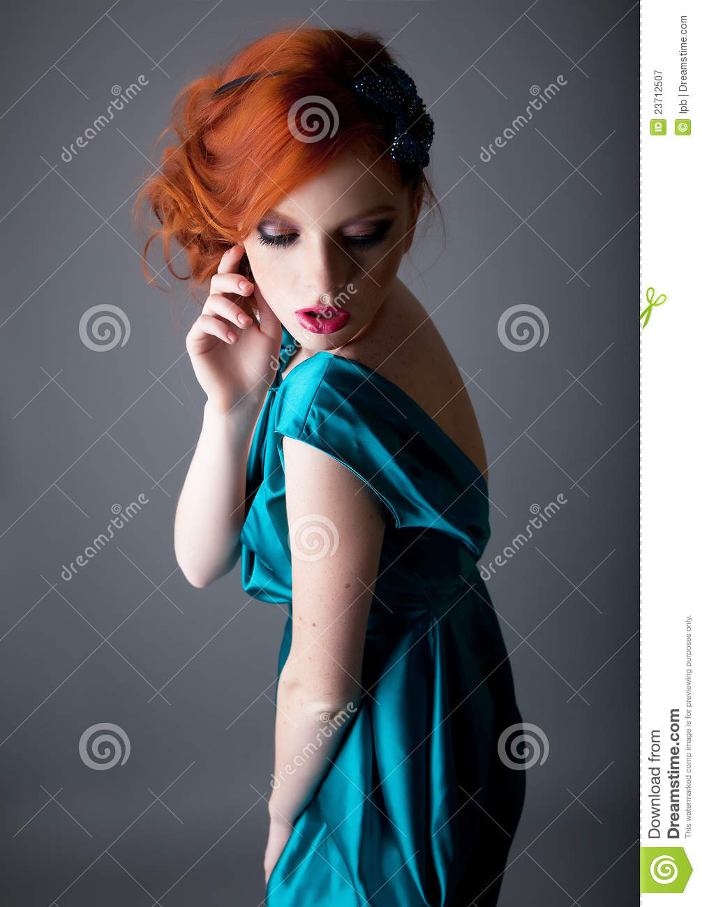 Portrait of lovely red head girl with freckle