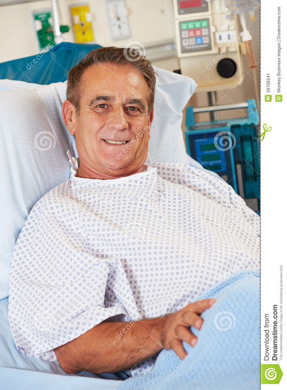 portrait of male patient relaxing in hospital bed stock