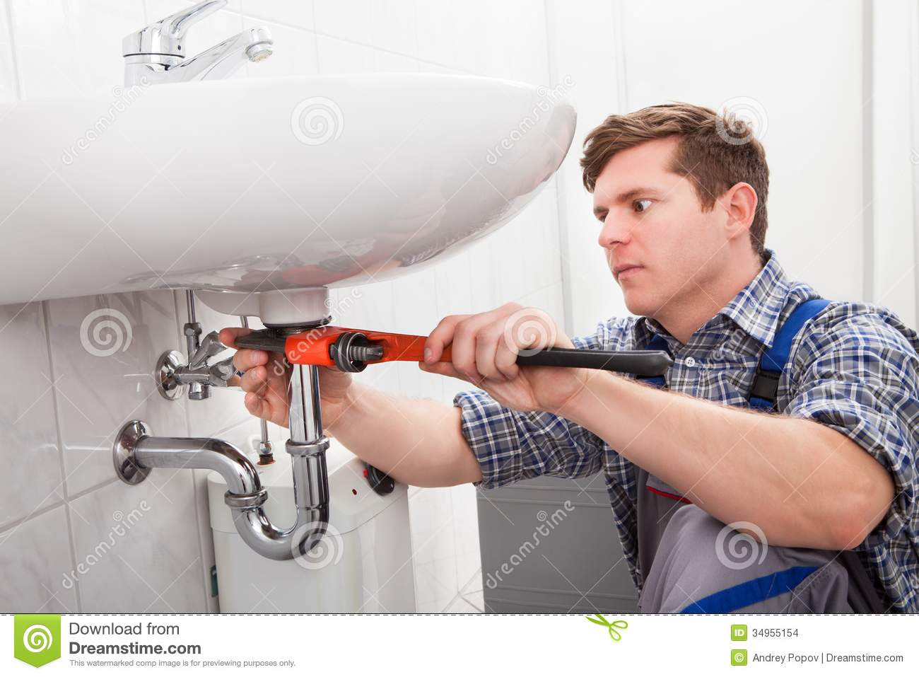Portrait Of Male Plumber Fixing A Sink Stock Photo Image