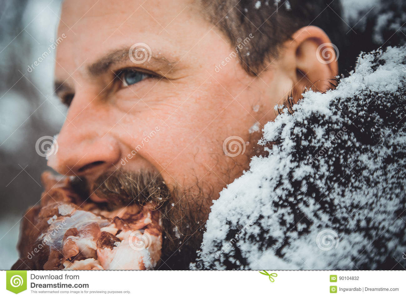 Portrait Of A Man With A Beard Devouring Raw Meat  Hungry Northern