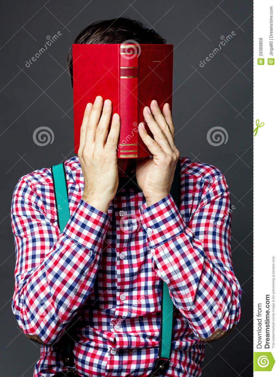 Book Covering Face : Portrait of a man covering his face with book royalty