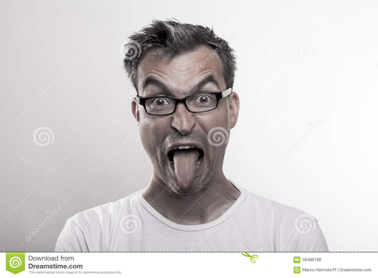 Portrait of a man in disgust poking out his tongue