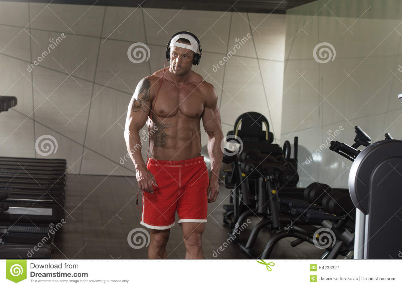 Portrait Of A Man In Gym Listening Music Stock Image - Image