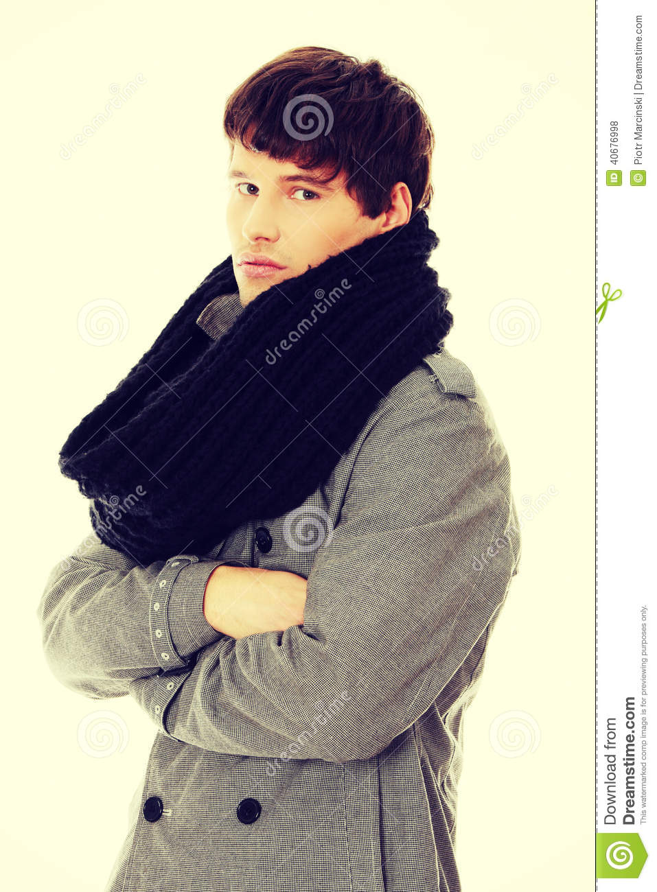Portrait man in scarf and coat.