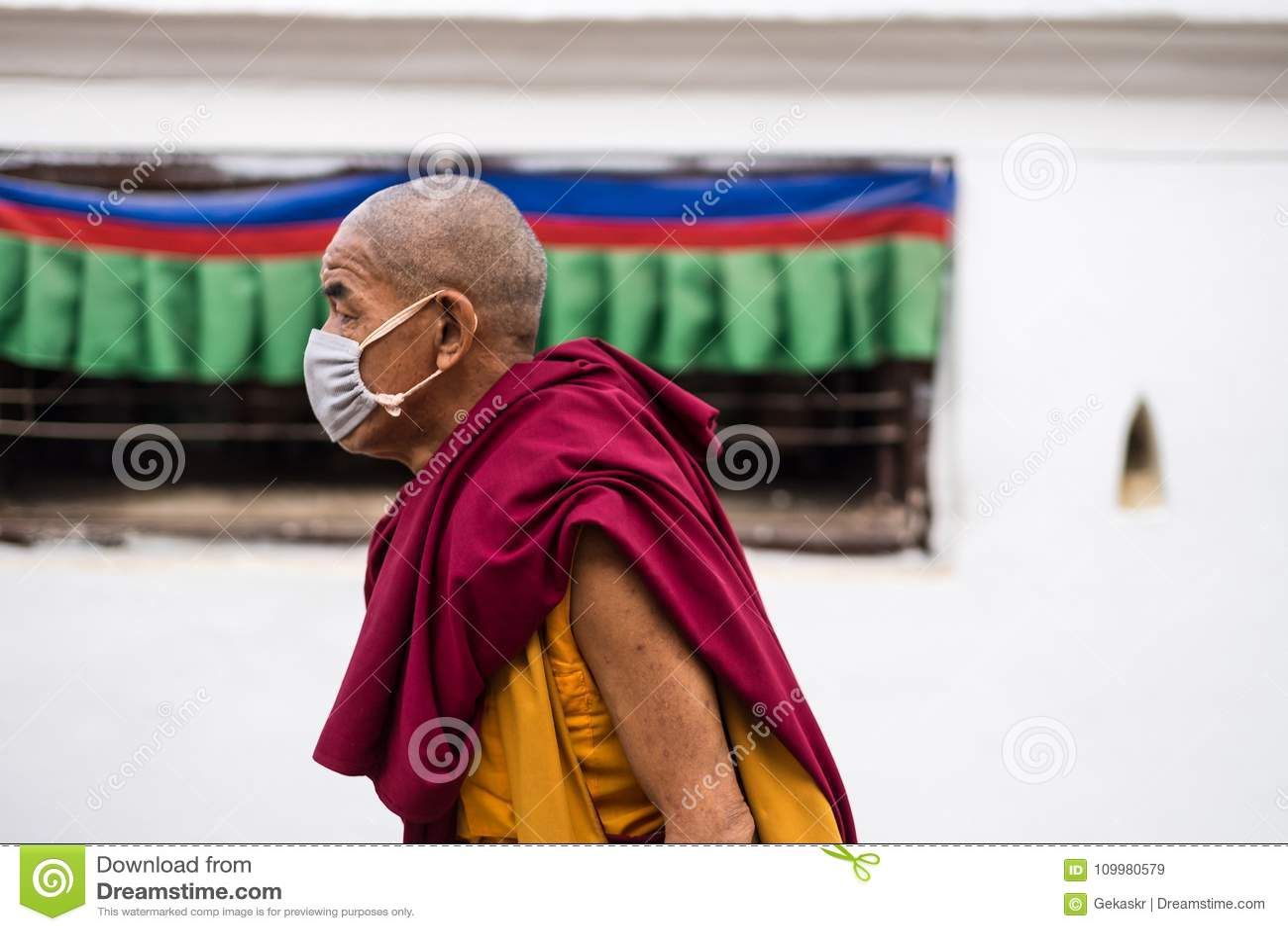 Portrait of a man on the streets of Kathmandu near Buddhist temple