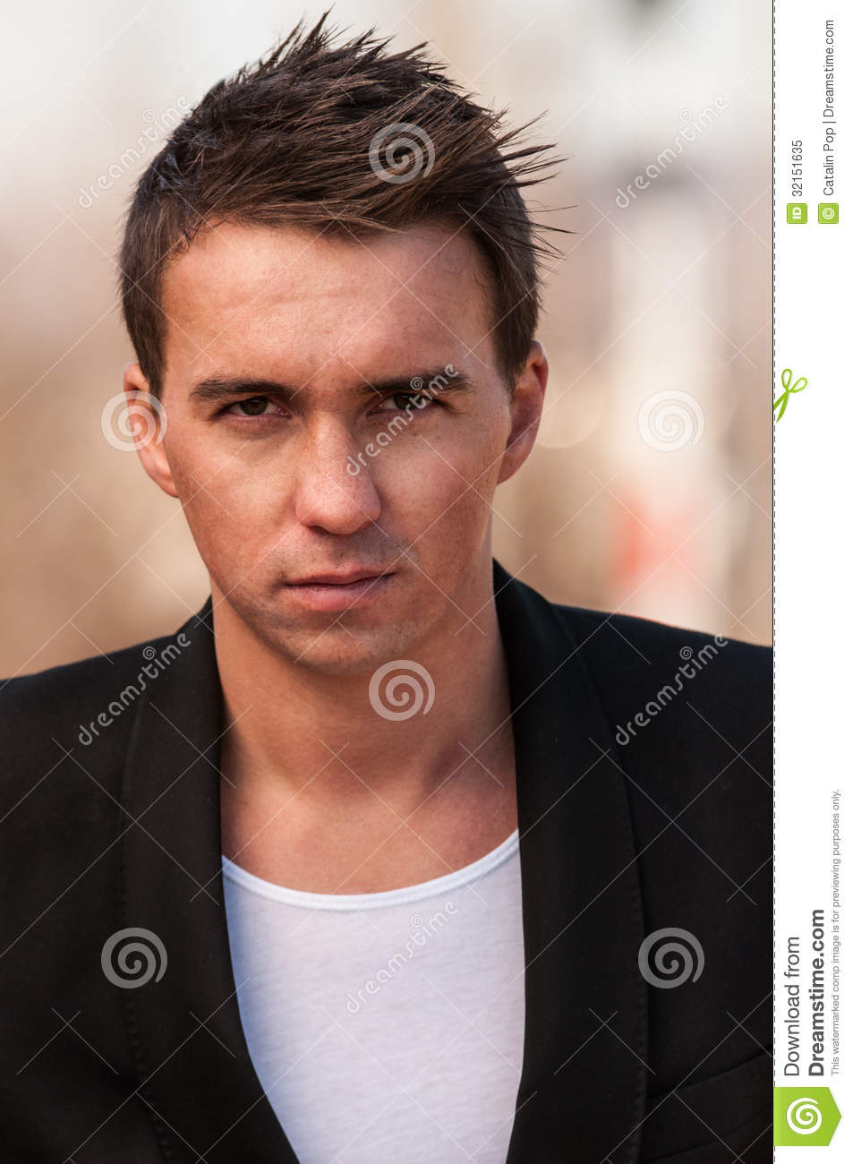 9405c270177c Portrait of a man wearing a black jacket and a white t-shirt underneath