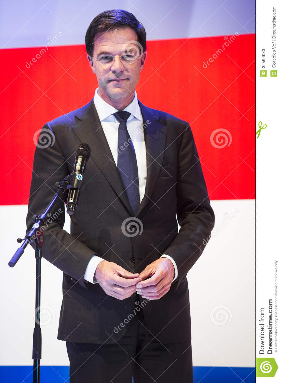 portrait of mark rutte in front of the dutch flag editorial stock