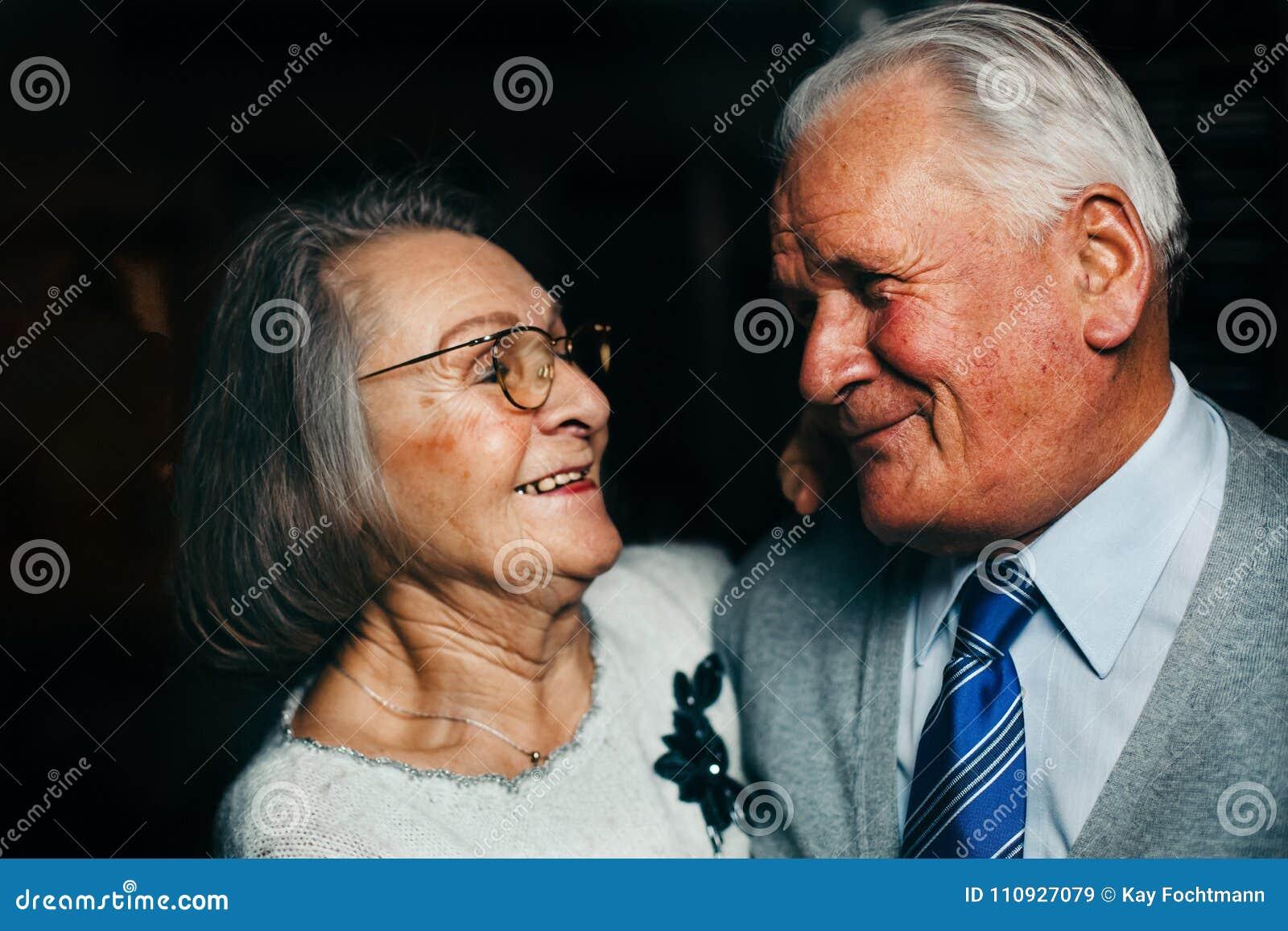 Portrait of elderly happy couple smiling
