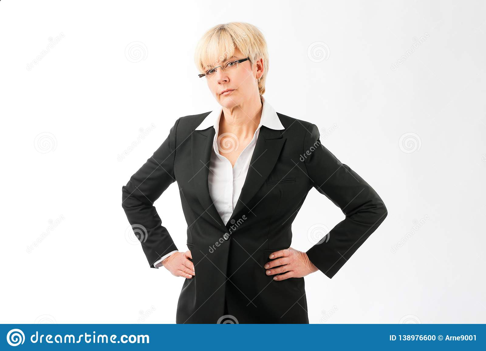 Portrait of mature businesswoman. With her hands on hip isolated over white background stock photo