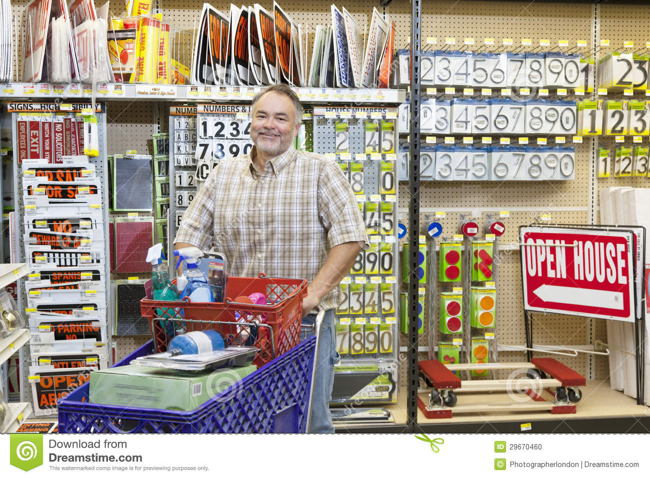 portrait of a mature man with shopping cart in hardware