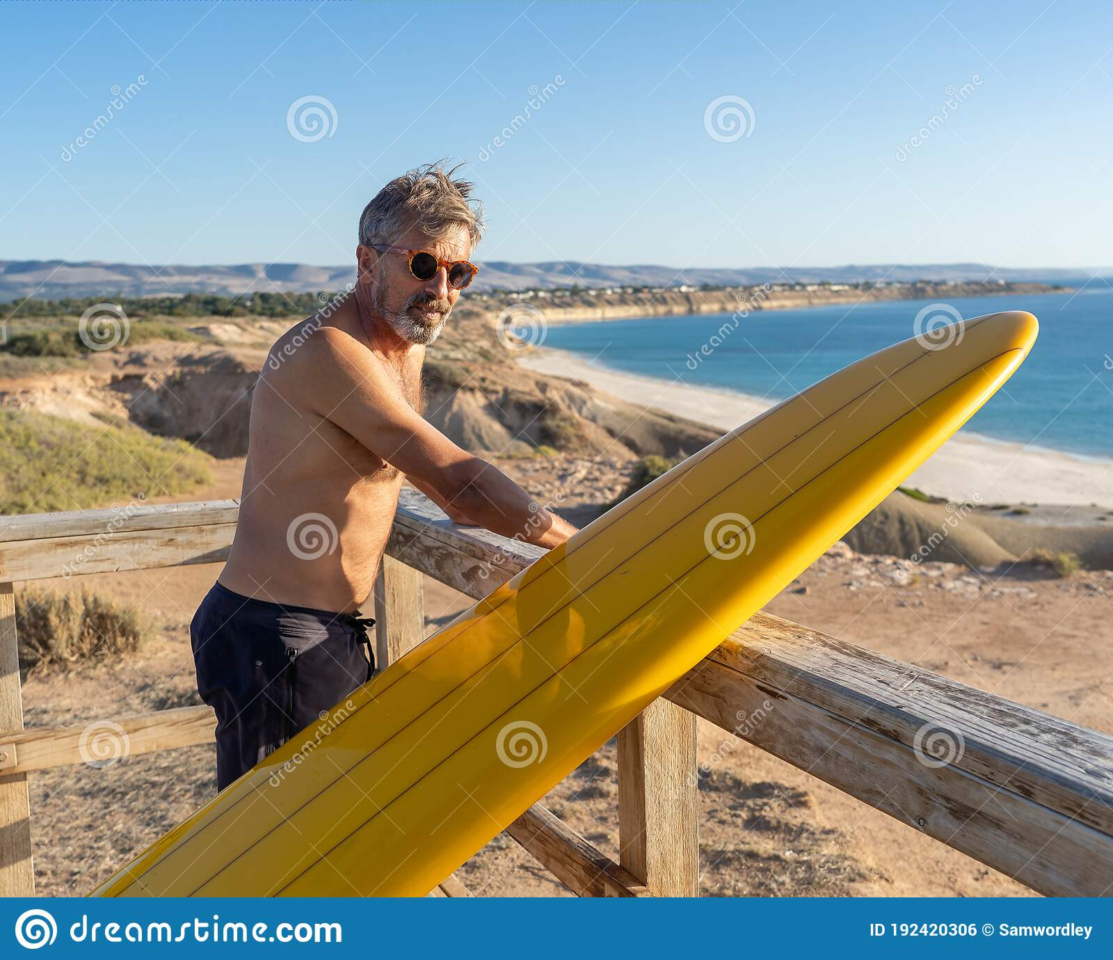 Portrait Of Mature Senior Surfer Looking At The Ocean With Vintage Surfboard On An Empty Beach Stock Photo Image Of Lifestyle Mature 192420306
