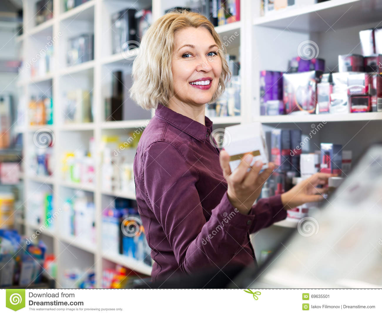 portrait of mature store clerk at household and cosmetic shop portrait of mature store clerk at household and cosmetic shop