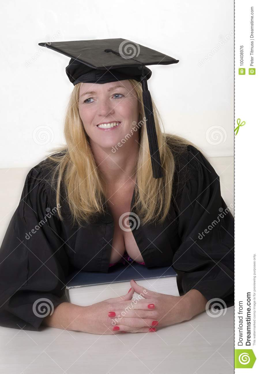 Mature University Student Wearing Cap And Gown Stock Photo - Image ...