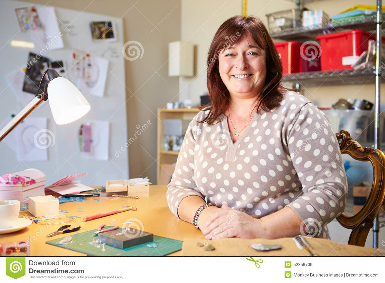 Portrait Of Mature Woman Making Jewelry At Home