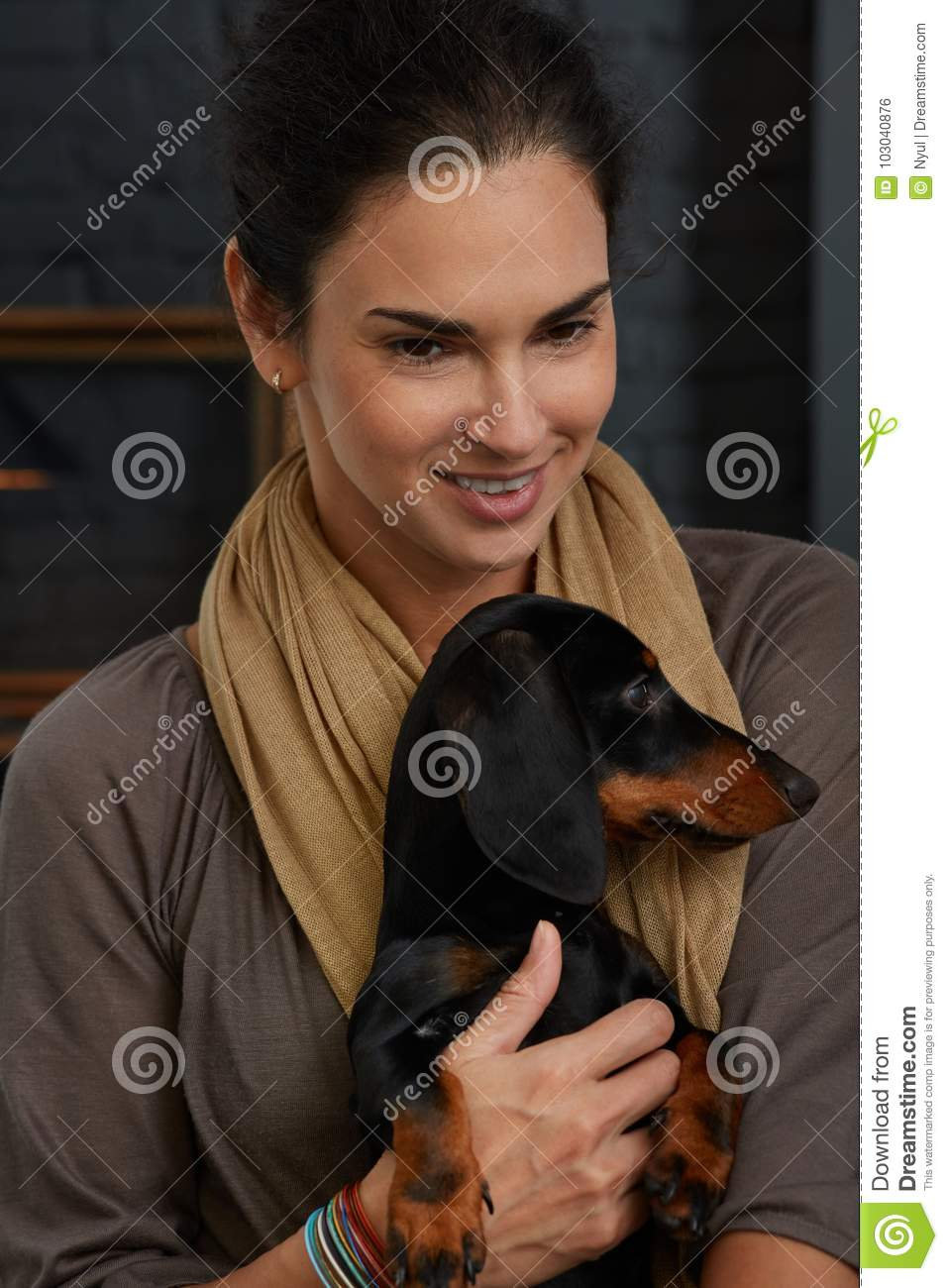 Mid adult woman with dog