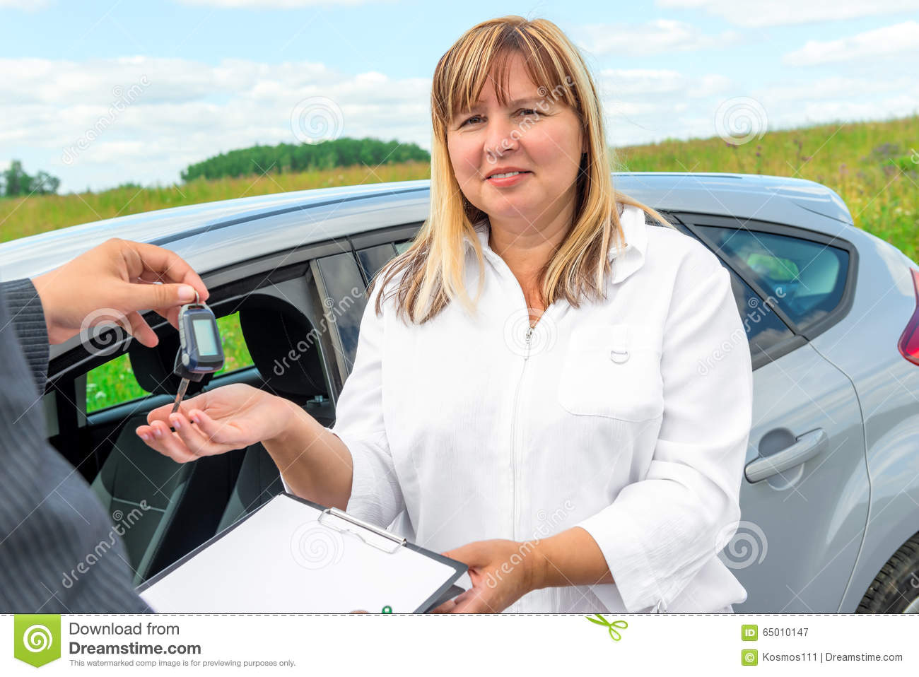 Portrait of a mature woman with a new car