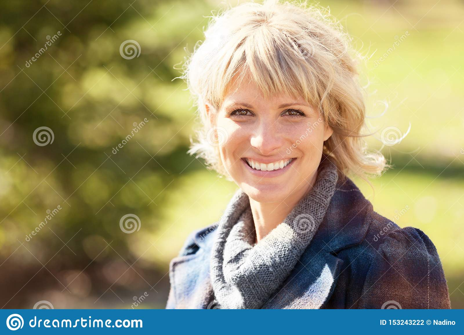 Portrait Of A Mature Woman Smiling At The Camera. She is really Happy in summertime