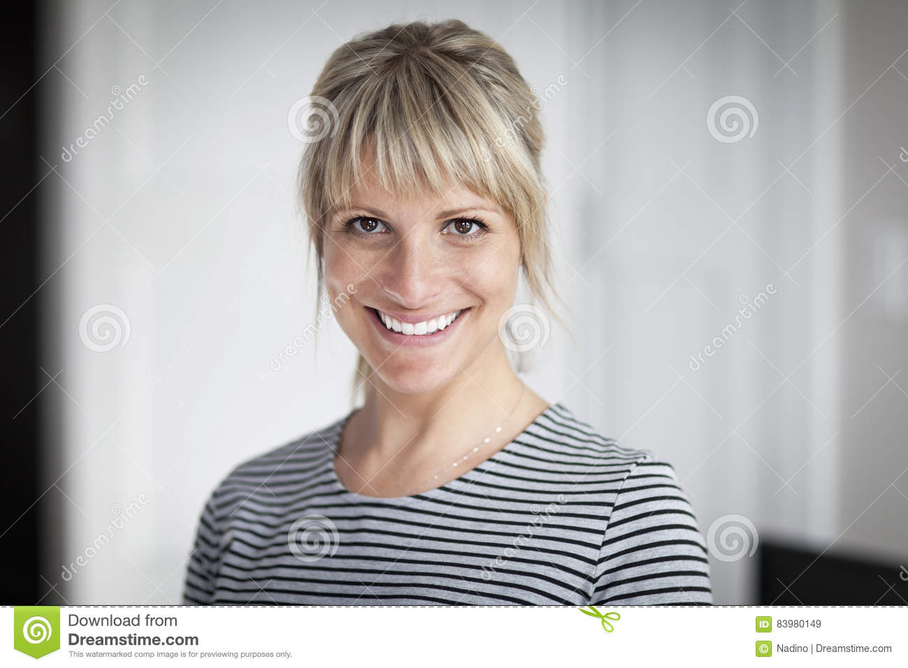 Portrait Of A Mature Woman Smiling At The Camera