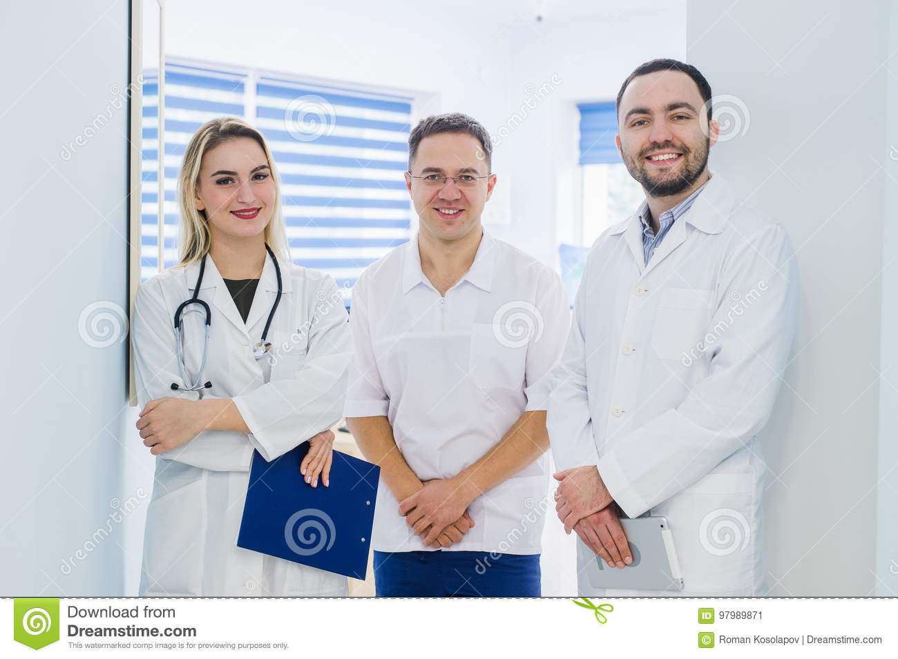Portrait of medical team standing in hospital hall