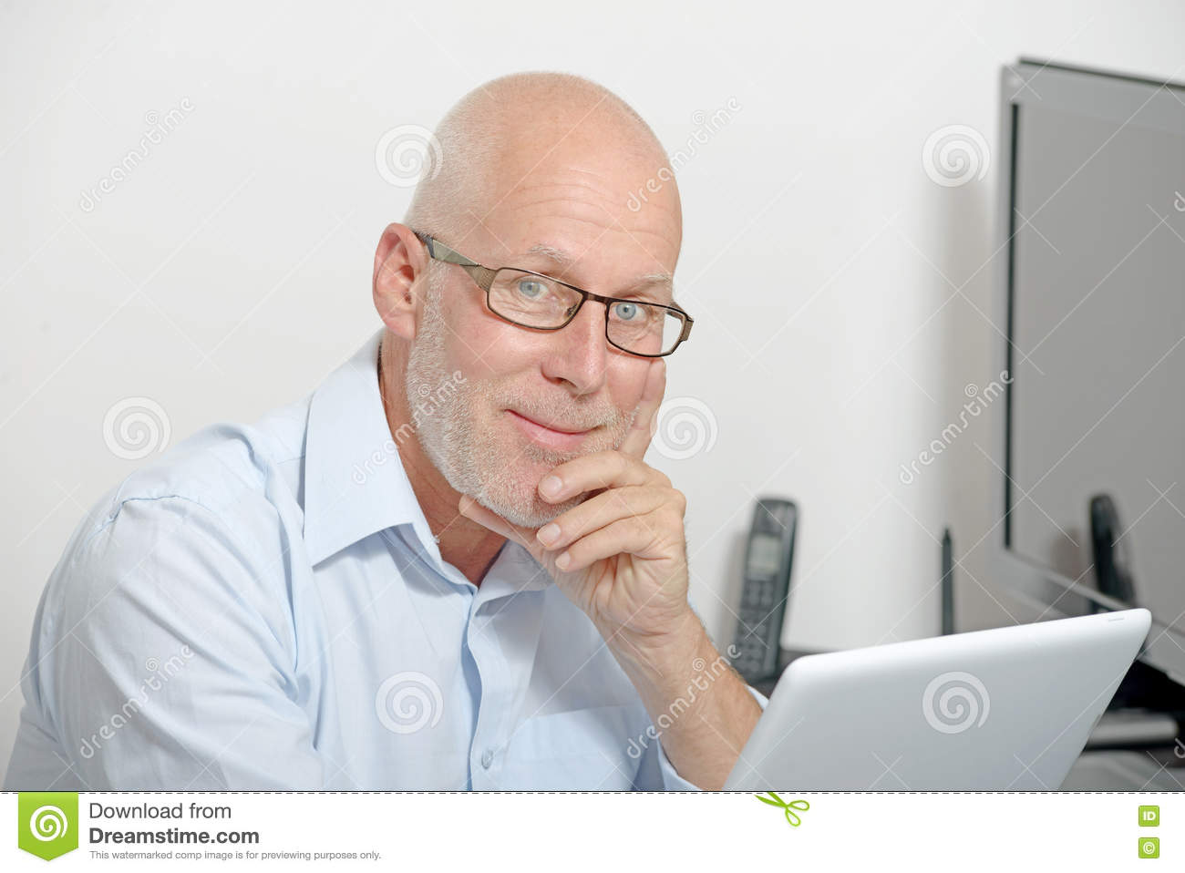 Portrait of a middle-aged man with a digital tablet