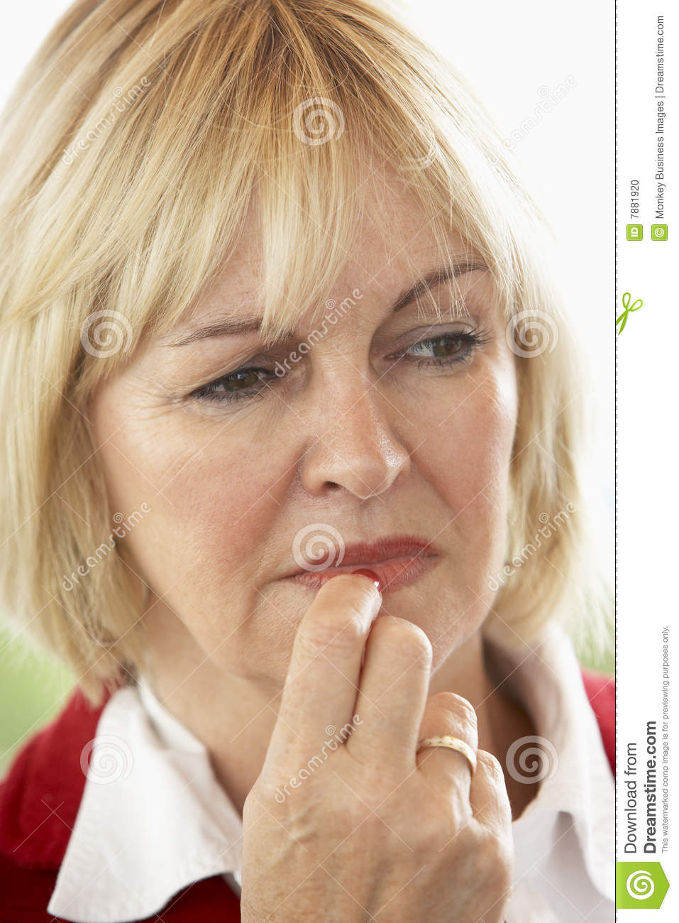 Portrait Of Middle Aged Woman Frowning