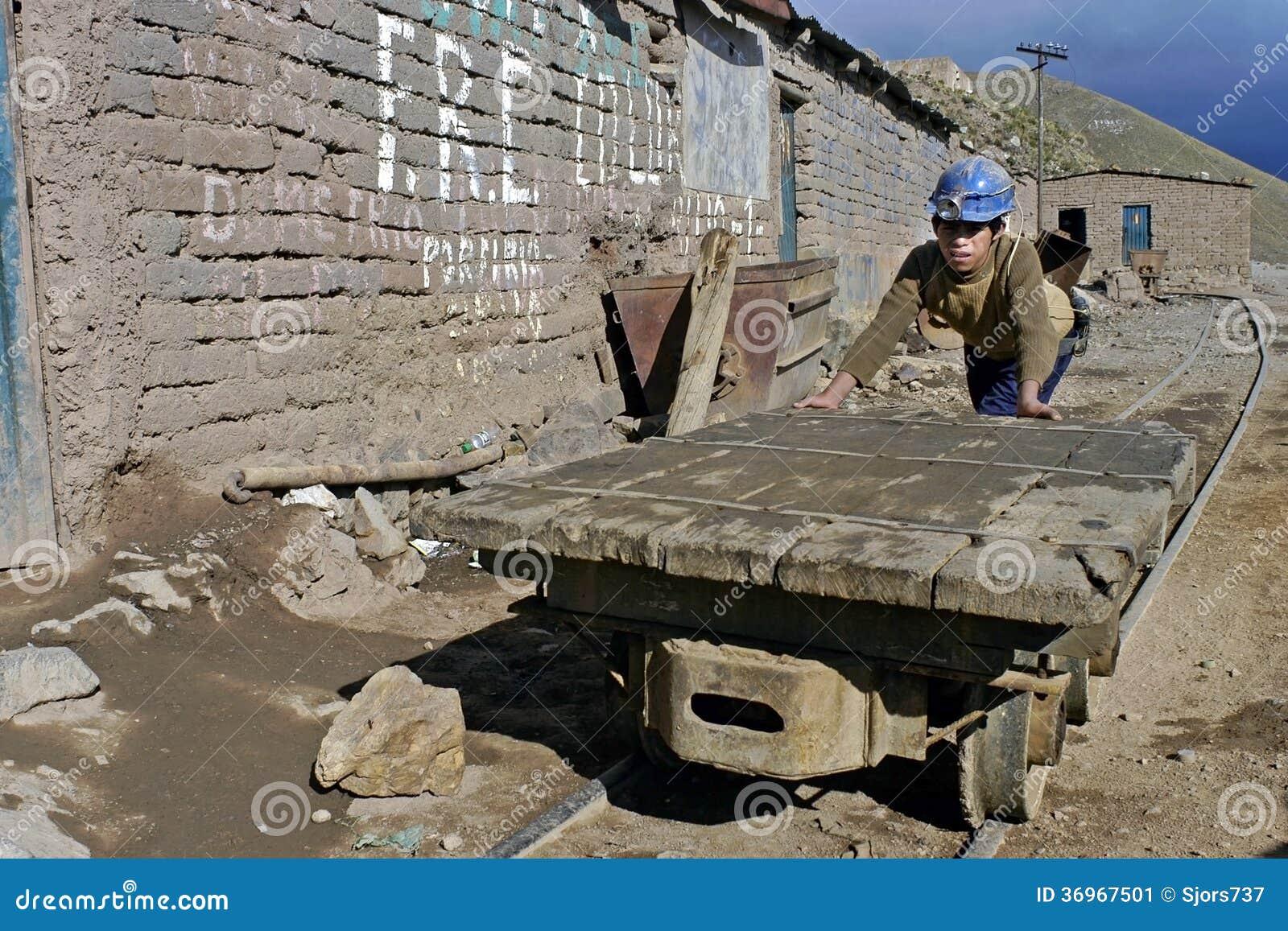 Child labor in a mine working Bolivian boy