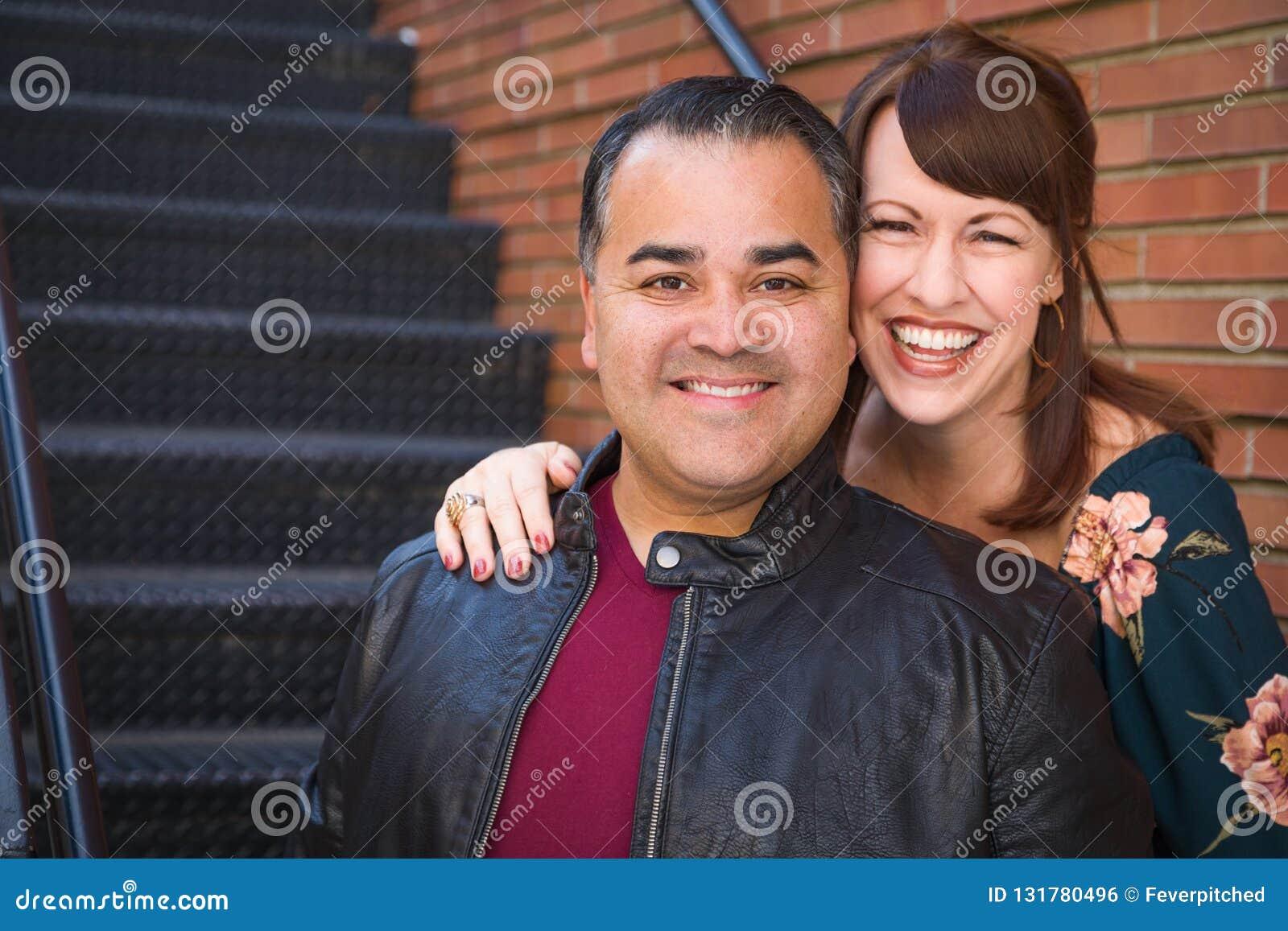 Laughing Mixed Race Caucasian Woman and Hispanic Man