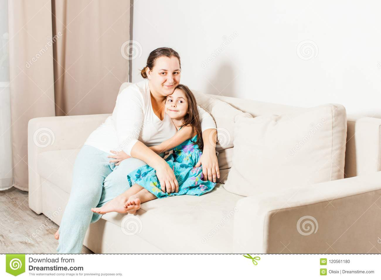 Portrait of mother and daughter at home.
