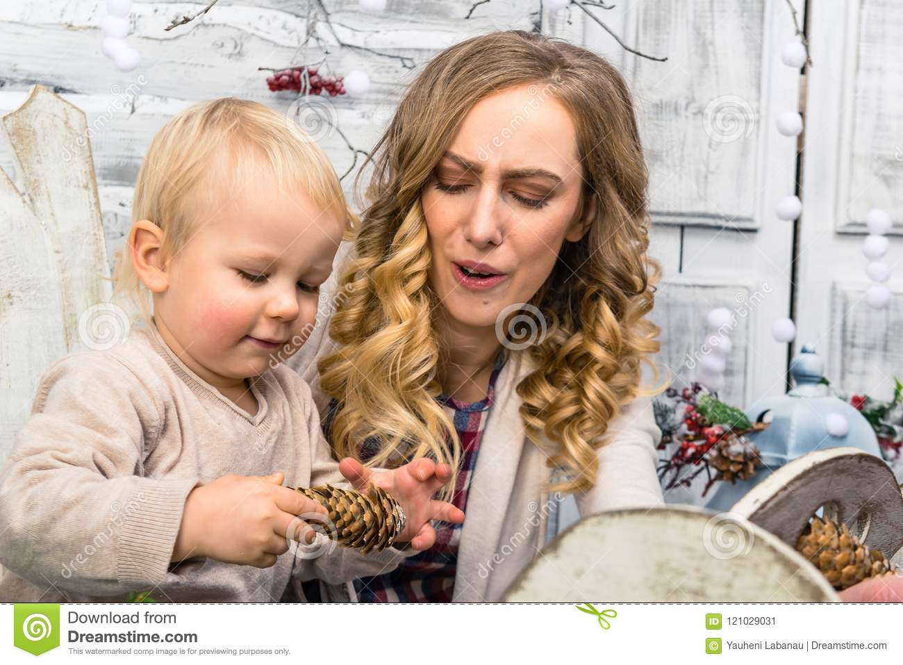 portrait of mother and her son in the decorated room little boy